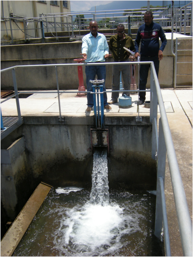 Clean water again! Plant manager Justin Mwikarago (left) with Serge and Emmanuel