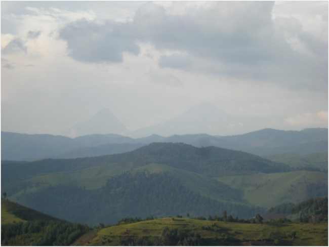 View to the north over Gishwati Forest, Mount Mikeno in DRC left, Karisimbi on the Rwanda-DRC border right