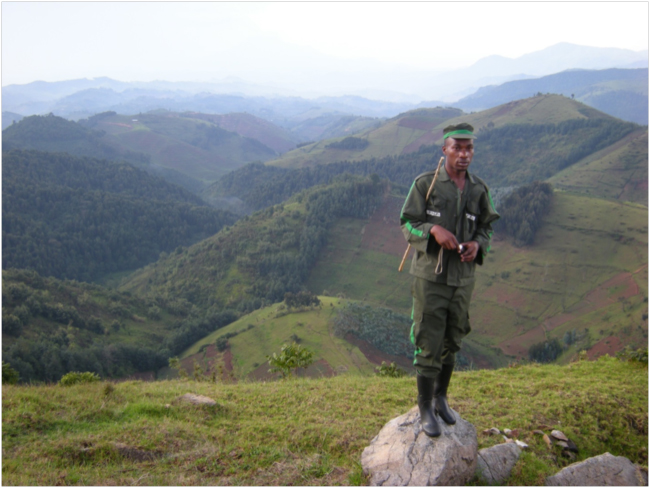Community Forest Guard with Gishwati Forest in background left