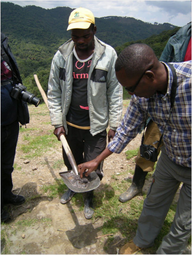 Serge examining the sample of coltan