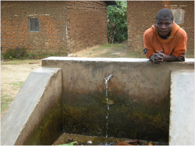 Water tap in a Batwa village, Cyamudongo