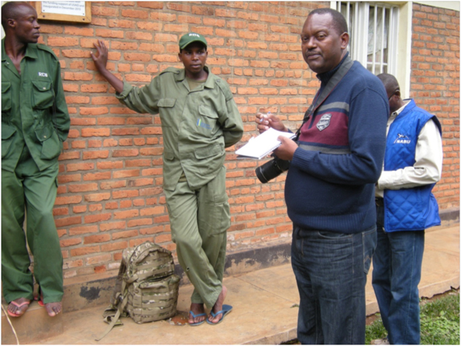 Emmanuel looking skeptical, interviewing rangers at the Cyamudongo Ranger Post