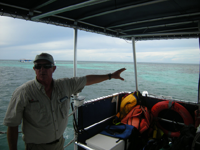 Snorkel boat captain orienting us to the reef