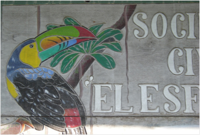 "Toucan on the sign at the office of Sociedad Civil ""El Esfuerzo"""