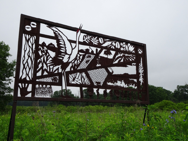 """Prairie Tapestry No. 1: Crane Clangor,"" ecological art by Glenn Wolff at the edge of Curtis Prairie, 20 June 2018."